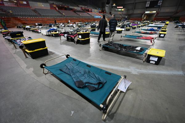 Socially distanced cots on the floor of the Mass Emergency Shelter operated by Bean's Cafe in the Sullivan Arena on a rainy Wednesday, April 14, 2021. (Bill Roth / ADN)