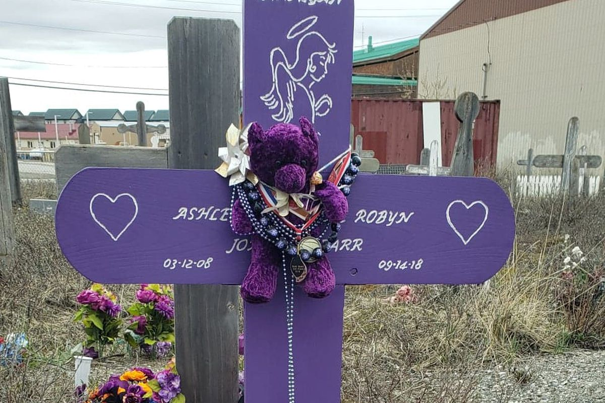 Ashley Johnson-Barr's grave is decorated with stuffed animals, angels, flowers and other items in the Kotzebue graveyard, May 2019. (Photo courtesy of Scotty Barr)