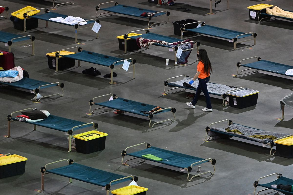 Cots on the floor of the Sullivan Arena where Bean's Cafe operates a mass shelter for homeless clients on Monday, July 19, 2021. (Bill Roth / ADN)