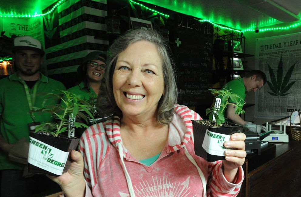 Sandi Hill purchased clones from the Green Degree on Thursday. (Bill Roth / Alaska Dispatch News)