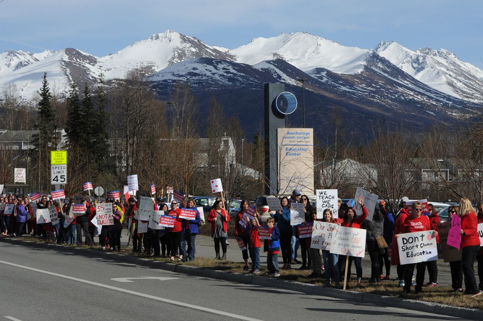 Hundreds of teachers lined Northern Lights Boulevard and Boniface Parkway during an
