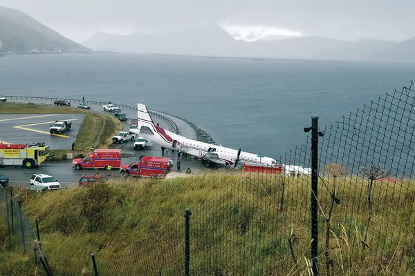 Rescue crews respond to a plane crash at the end of the runway at the Unalaska airport on October 17, 2019. (Photo by Erin Enlow)