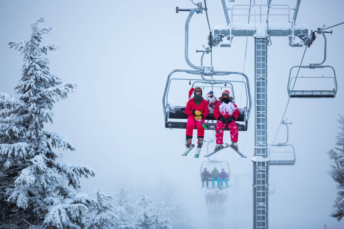 Max Waugaman, left, and John Whitworth ride the chairlift up Mt. Alyeska on December 24, 2015. Alyeska Resort traditionally offers free Christmas Eve lift tickets to skiers and snowboarders dressed in Santa outfits, a perk over 600 people took advantage of this year. (Loren Holmes / ADN)