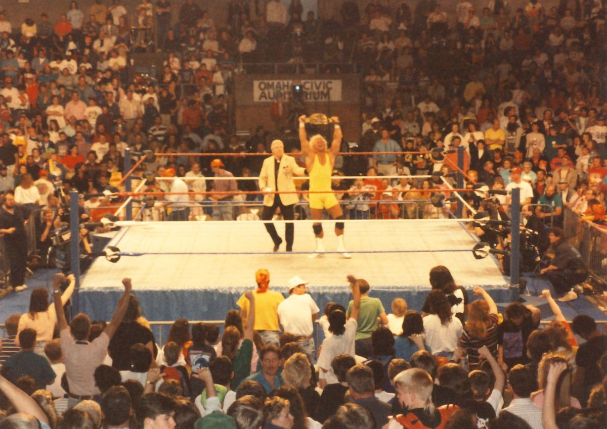 """""""Mr. Perfect,"""" aka Curt Hennig, celebrating after an April 15, 1991, victory in Omaha, Nebraska. Super fans regard a 1989 match between Mr. Perfect and Bret """"The Hitman"""" Hart in Anchorage as a WWF holy grail, but no recording has ever surfaced. (Photo byInFlamester20 via Creative Commons)"""
