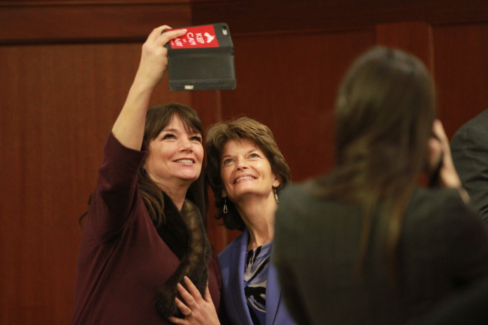 Anchorage Republican Rep. Charisse Millett, left, shoots a selfie with U.S. Sen. Lisa Murkowski at the Capitol in February. (Nathaniel Herz / Alaska Dispatch News)