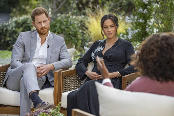 This image provided by Harpo Productions shows Prince Harry, left, and Meghan, Duchess of Sussex, in conversation with Oprah Winfrey.