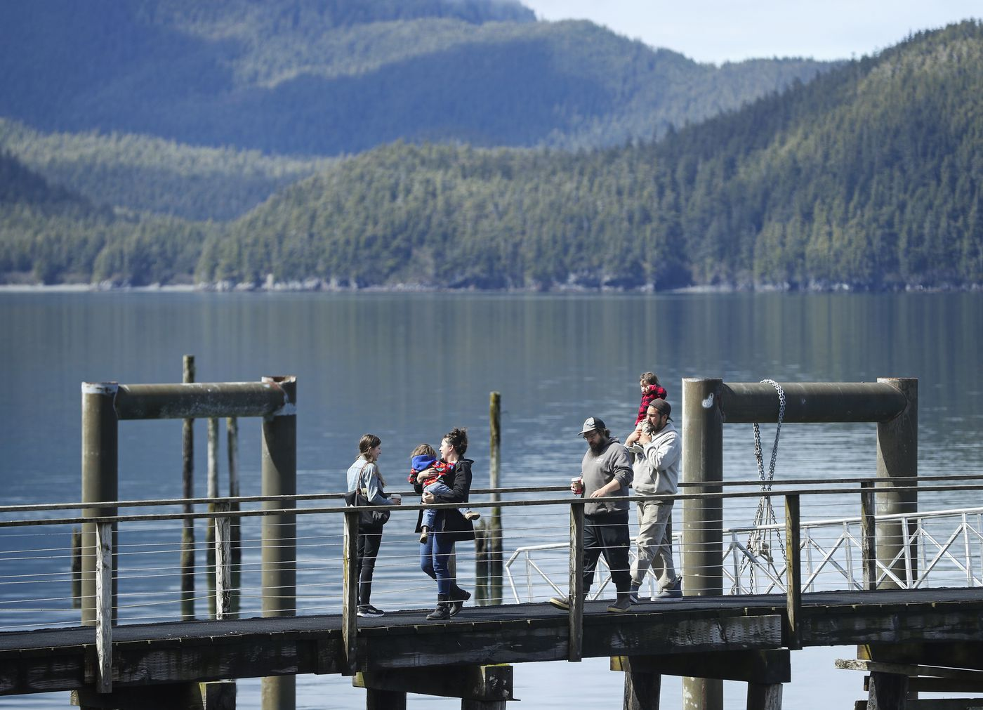 People walk back to shore after looking at Orca Inlet from a dock at the end of Orca Road in Cordova on Saturday, May 22, 2021. (Emily Mesner / ADN)
