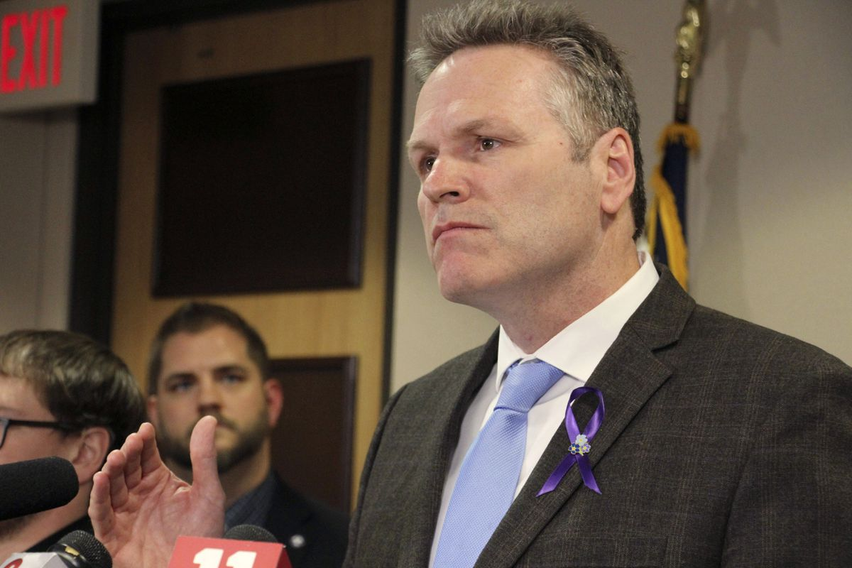 FILE - In this March 12, 2020 file photo, Alaska Gov. Mike Dunleavy speaks during a news conference in Anchorage, Alaska. Dunleavy faces criticism for his handling of COVID-19, from those who think he's not doing enough to address rising case counts to those who think he's been overreaching. (AP Photo/Mark Thiessen, File)