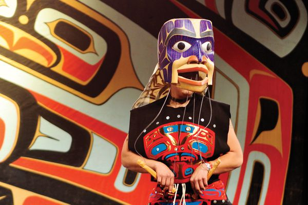 Nick James wears The Spirit of the Potlatch Mask, carved by dance leader David Boxley. The mask represents the returning spirits of the old potlatches.