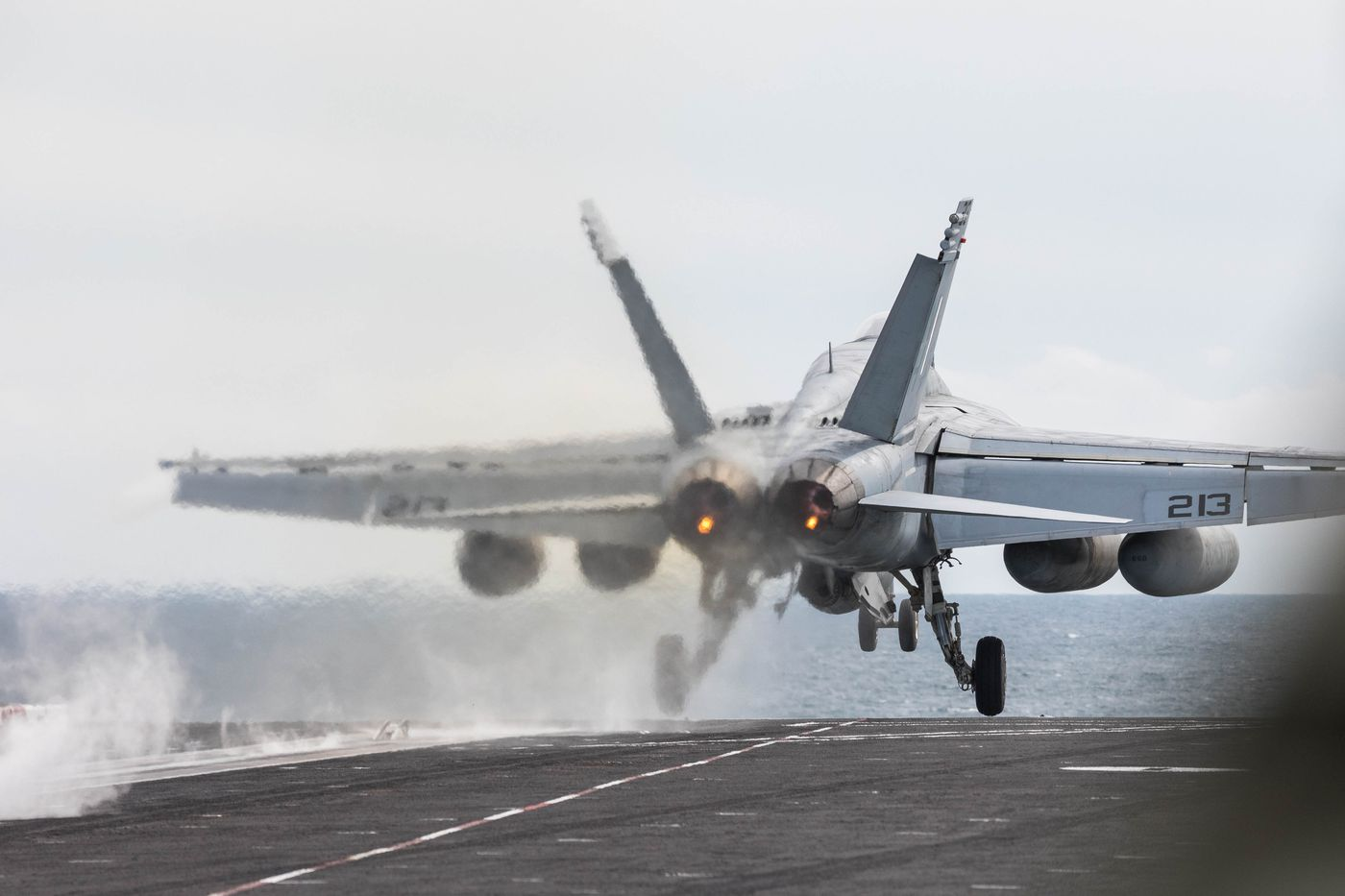 A F/A-18 Super Hornet takes off on Wednesday from the USS Theodore Roosevelt Nimitz-class aircraft carrier in the Gulf of Alaska south of Seward. The Roosevelt can carry over 60 aircraft at once, including fighter jets, airborne command and control aircraft, helicopters and cargo aircraft. (Loren Holmes / ADN)