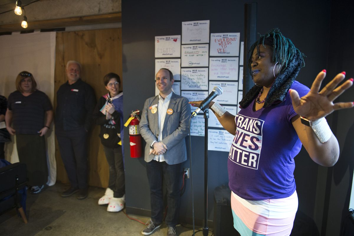 MoHagani Magnetek speaks to other opponents of Proposition 1 who gathered at Williwaw on April 3, 2018. (Marc Lester / ADN)