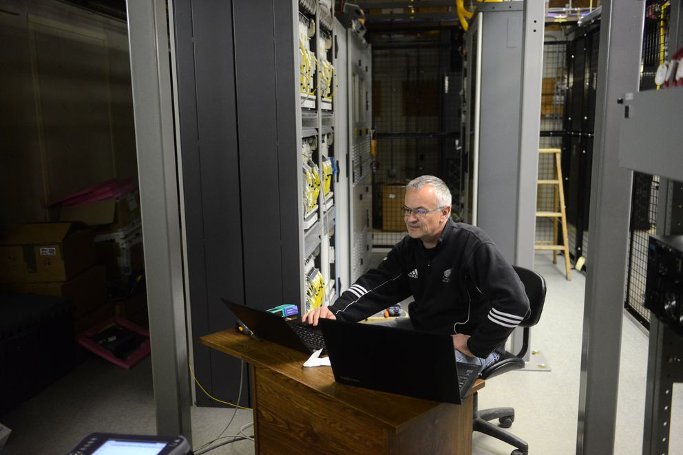 Marc Andre runs local tests on the new switching equipment at the TelAlaska facility for the fiber-optic line being installed by Quintillion in Nome on Aug. 22, 2016. (Bob Hallinen / Alaska Dispatch News)