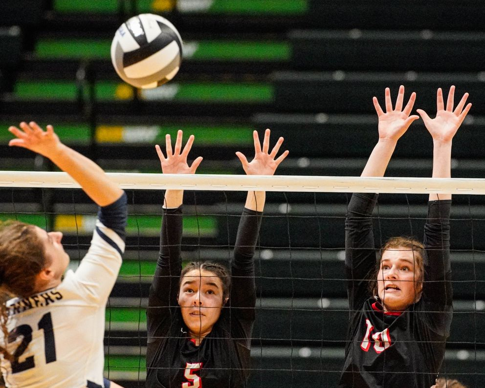 Kenai's Chelsea Plagge and Abby Every try to block an attack by Homer's Marina Carroll. (Loren Holmes / ADN)