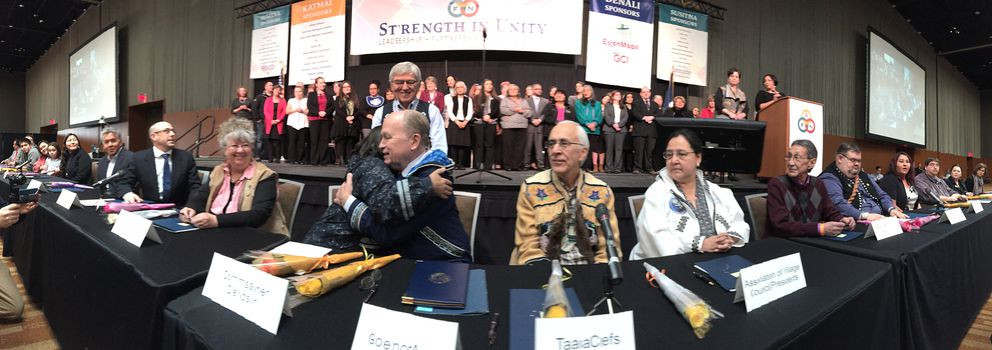 Department of Health and Social Services Commissioner Valerie Davidson, left, and Gov. Bill Walker, right, embrace during the historic signing of the Alaska Tribal Child Welfare Compact with tribal leaders on the first day of AFN at the Dena'ina Center in Anchorage on Thursday, Oct. 19, 2017. (Bill Roth / Alaska Dispatch News)