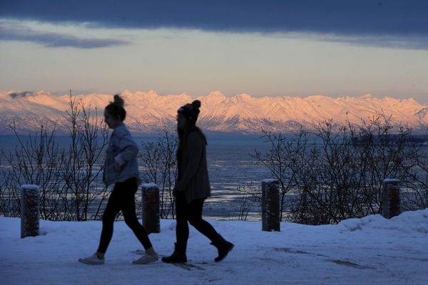 Shyla Lundy and Carly Hill took in the view of the Talkeetna Mountains from an overlook at Northern Lights Boulevard and Postmark Drive on Wednesday, Jan. 9, 2019. A blast of cold arctic air from the north is expected to bring temperatures down to minus 20 in Anchorage and minus 30 in the Susitna Valley.(Bill Roth / ADN)