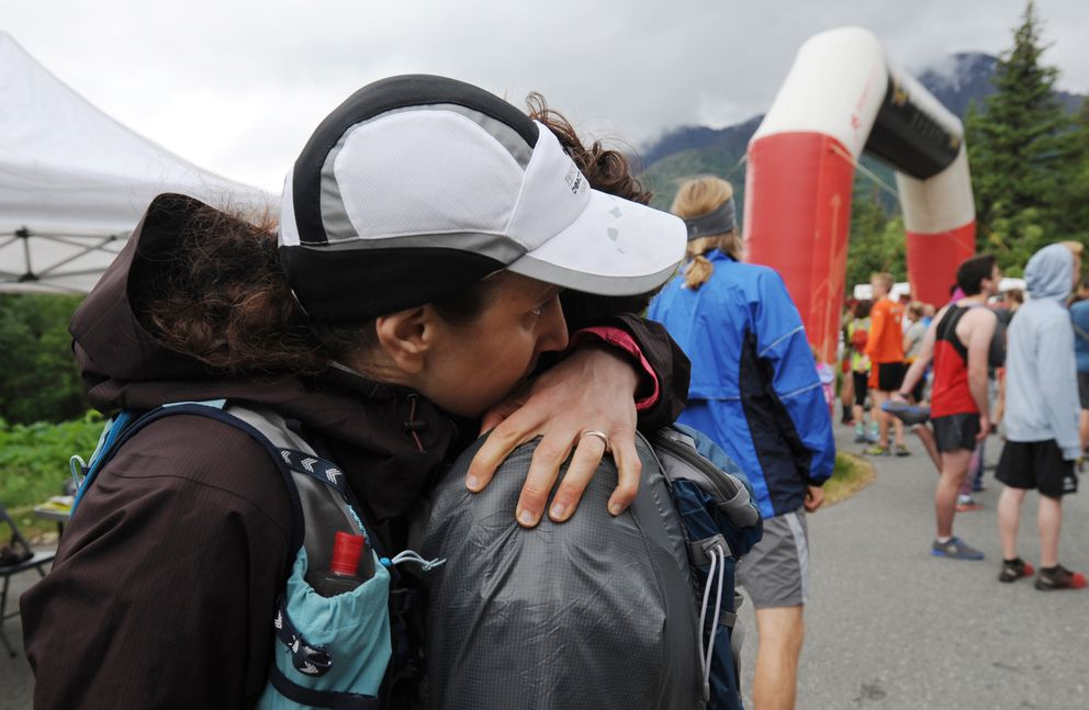 "Katrina Garner embraces Rose Garner prior to the start of the Robert Spurr Memorial Hill Climb on Sunday, June 17, 2018. Their son Patrick ""Jack"" Cooper was fatality mauled by a black bear after last years race. (Bill Roth / ADN)"