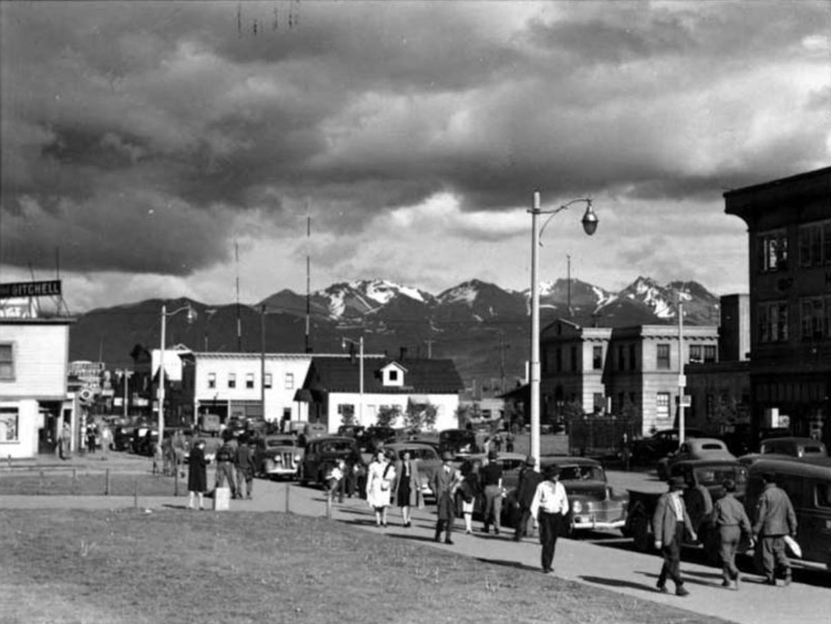 View of 4th Avenue and F Street, Anchorage, Alaska, looking south from the grounds of the Federal Building in the 1940s. Buildings shown include The Gitchell Hotel and City Hall. (Photo by Sidney H. Hamilton, Sidney Hamilton Photograph Collection; Anchorage Museum, Gift of Emily Turner, B1976.82.18.)