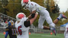 East starts fast, rallies late to beat rival Bartlett 27-20 and earn East Side Boot