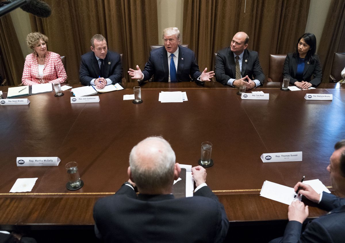 President Donald Trump speaks during a bipartisan meeting with lawmakers regarding tax policy, at the White House in Washington, Sept. 13, 2017. From left: Rep. Susan Brooks, (R-Ind.), Rep. Josh Gottheimer (D-N.Y.), Trump, Rep. Tom Reed (R-N.Y.) and Rep. Stephanie Murphy (D-Fla.). In the foreground at center is John Kelly, the White House chief of staff. (Doug Mills/The New York Times)
