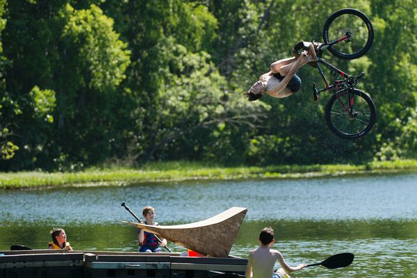 Dylan Ceder-Reinke, 13, hits a ramp at the end of a floating dock and does a back flip into Little Campbell Lake on June 10, 2019. Ceder-Reinke, who said he first attempted the stunt last summer, said he likes that the trick is relatively low risk when done into water. (Marc Lester / ADN)