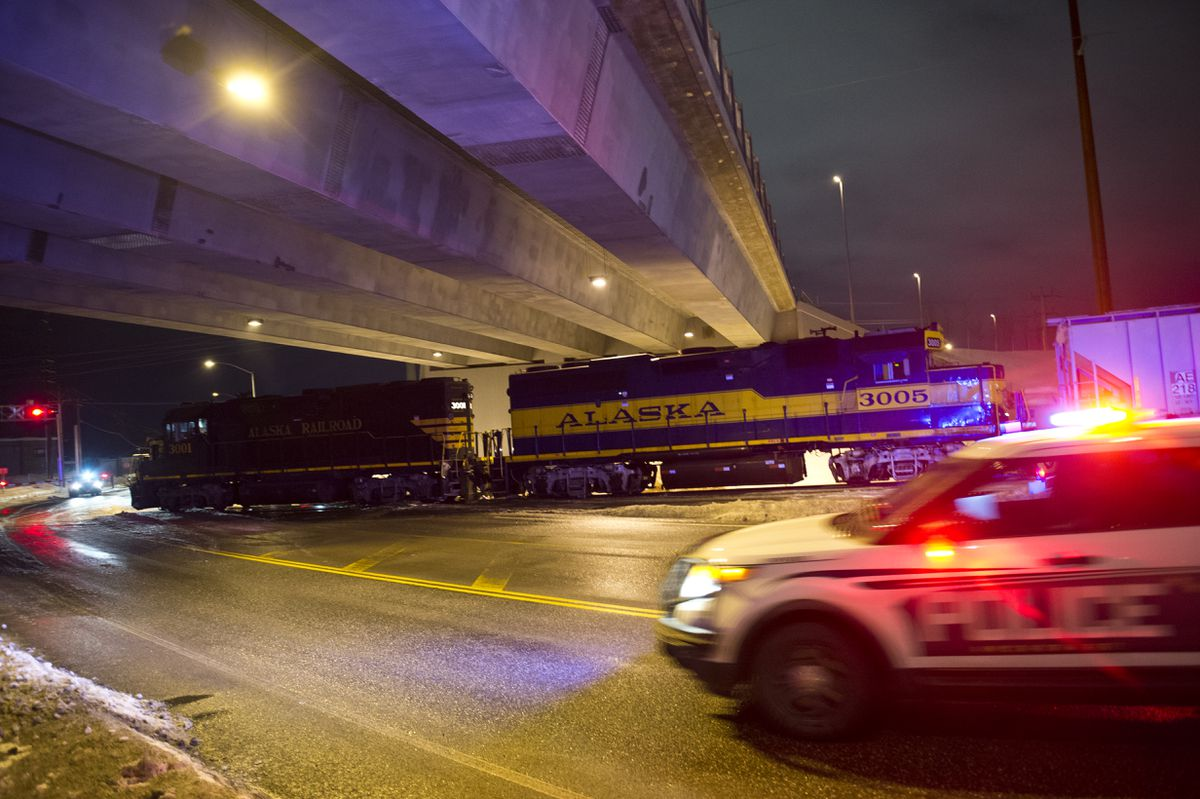 An Alaska Railroad train is stopped on Arctic Boulevard under the Dowling Road overpass. Anchorage Police said a woman was struck and killed by a train Tuesday evening. (Marc Lester / ADN)