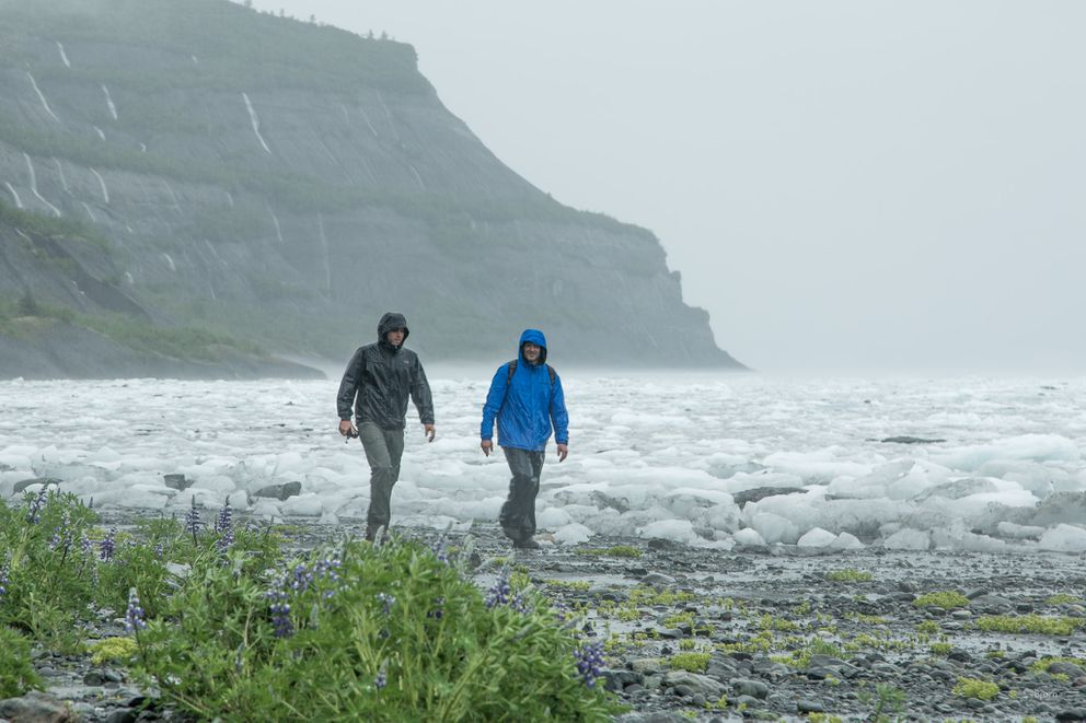 Vasillios Skanavis and Dr. Pat Lynett make their way back to the helicopter after inspecting the coastline for tsunami run-up. (Bjorn Olson / Ground Truth Trekking)