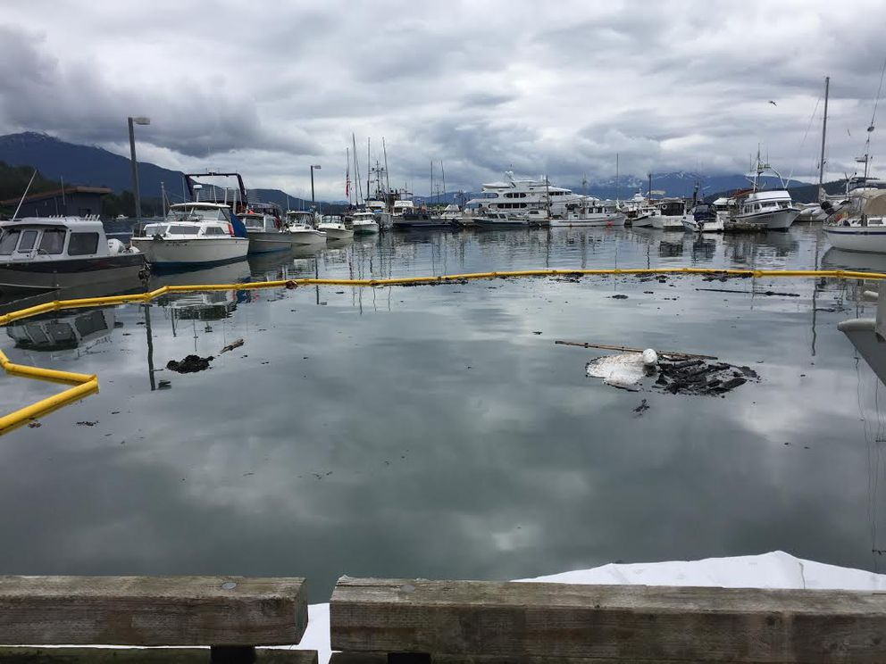 A 42-foot boat caught fire in Juneau early Tuesday, then sank to the bottom of Statter Harbor in Auke Bay. Officials are investigating the cause of the flames. (Alaska Department of Environmental Conservation)