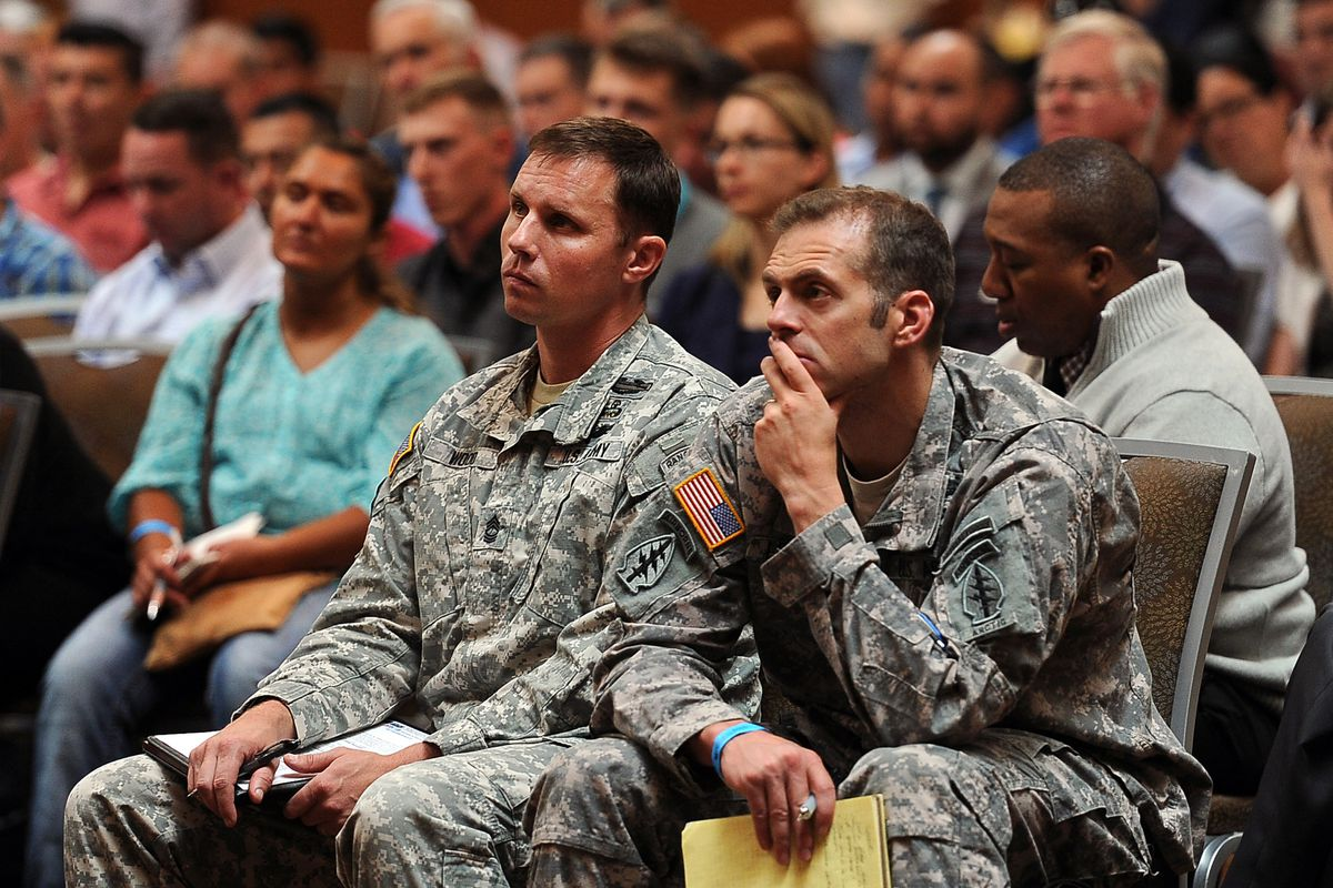U.S. Army Master Sgt. Joseph Wood, left, and Master Sgt. Michael Lindsay listen to advice from panelists at the JBER Transition Summit on Wednesday, July 22, 2015, at the Dena'ina Civic and Convention Center.