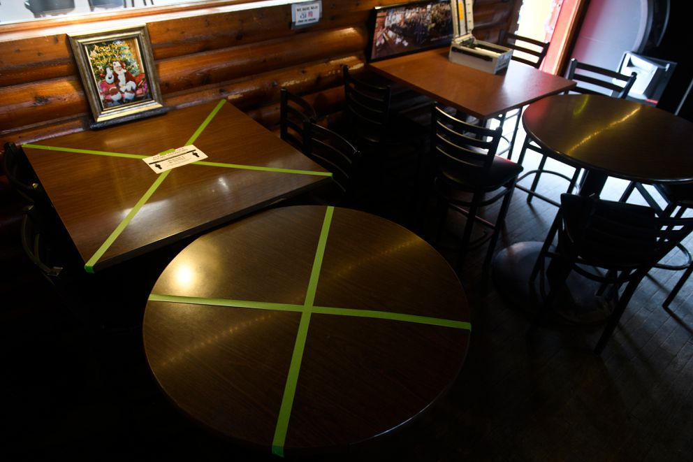 Tables are taped off to space customers at Crossroads Lounge. Photographed on May 7, 2020. (Marc Lester / ADN)