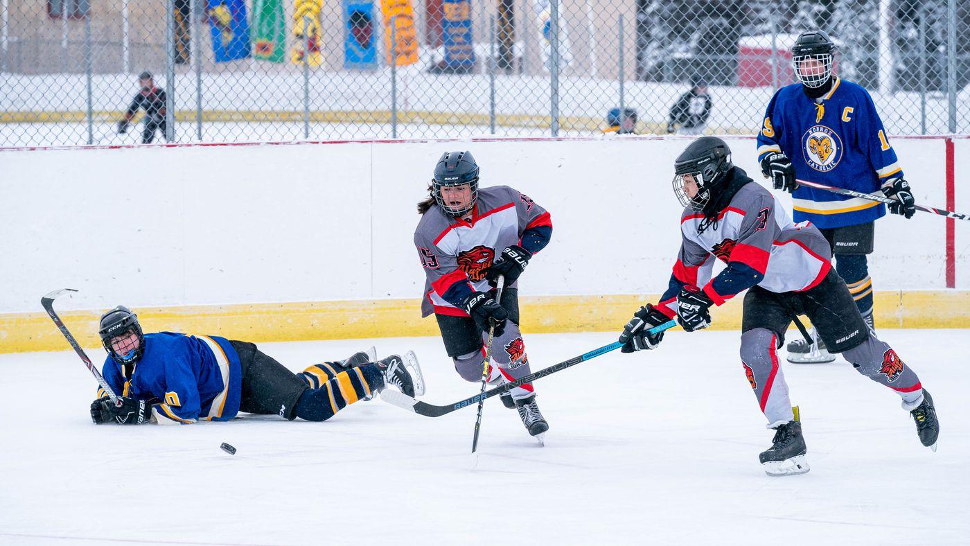 Alaska Heat defenseman Cassidy Matthews and forward Christopher Spring chase after the puck. (Loren Holmes / ADN)