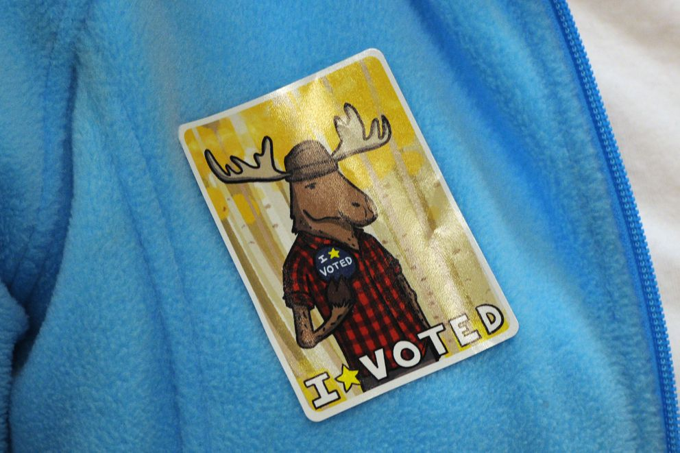 An election official wore one of the new early voting stickers on Election Day, Tuesday, Nov. 6, 2018. (Bill Roth / ADN)