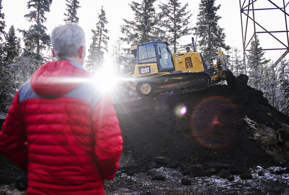 John DeHaven watches as a bulldozer levels out a mound of dirt at Hilltop. About 900 cubic yards of dirt has been used on the program so far. (Emily Mesner / ADN)