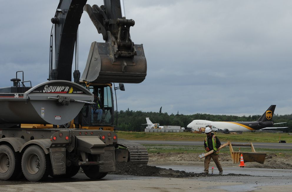 A UPS Boeing 747 taxis for takeoff as construction work continues on the north/south runway at Ted Stevens Anchorage International Airport on Monday, July 9, 2018. (Bill Roth / ADN)