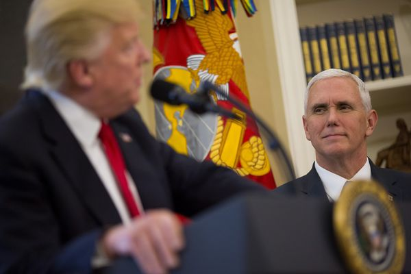 FILE -- Vice President Mike Pence looks at President Donald Trump in the Oval Office of the White House in Washington, March 31, 2017. Pence appears to be cementing his status as Trump's heir apparent, promoting himself as the conduit between Republican donors and the administration. (Eric Thayer/The New York Times)