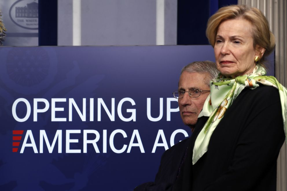 FILE - In this April 16, 2020, file photo, Dr. Anthony Fauci, director of the National Institute of Allergy and Infectious Diseases, and Dr. Deborah Birx, White House coronavirus response coordinator, listen during a briefing about the coronavirus in the James Brady Press Briefing Room of the White House in Washington. (AP Photo/Alex Brandon, File)