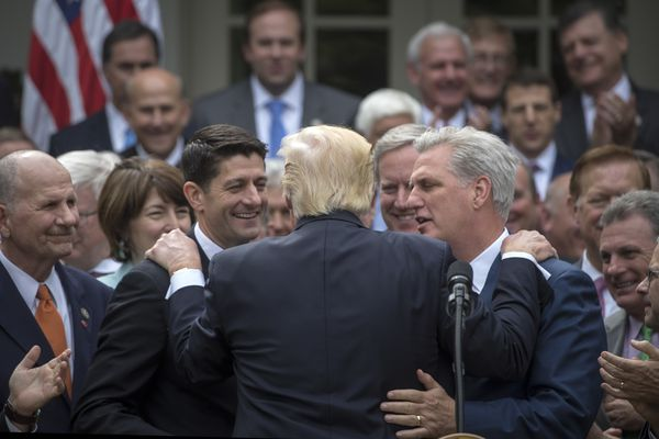 President Donald Trump is embraced by House Republican leaders as they came to the White House to celebrate the passage of the American Health Care Act, in Washington, May 4, 2017. The bill faces a more uncertain future in the Senate. From left: House Speaker Paul Ryan (R-Wis.); Trump; Rep. Mark Meadows (R-N.C.), who heads the Freedom Caucus; and House Majority Leader Kevin McCarthy (R-Calif.). (Stephen Crowley/The New York Times)