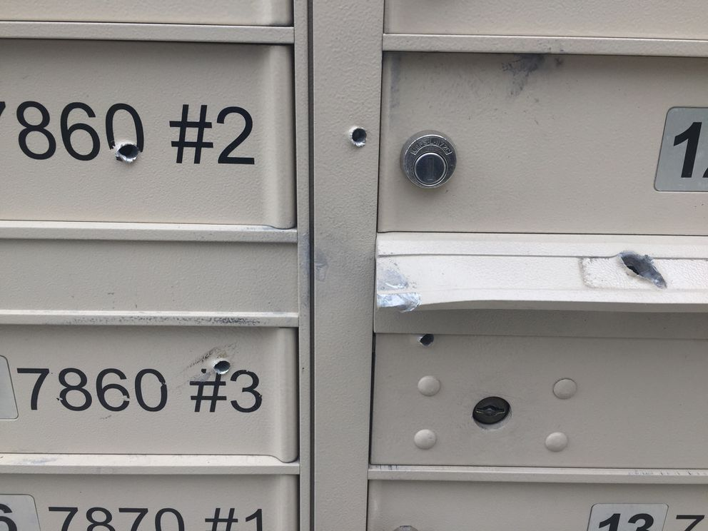 Mailboxes with bullet holes at Grass Creek Village on Tuesday morning (Erik Hill / Alaska Dispatch News)