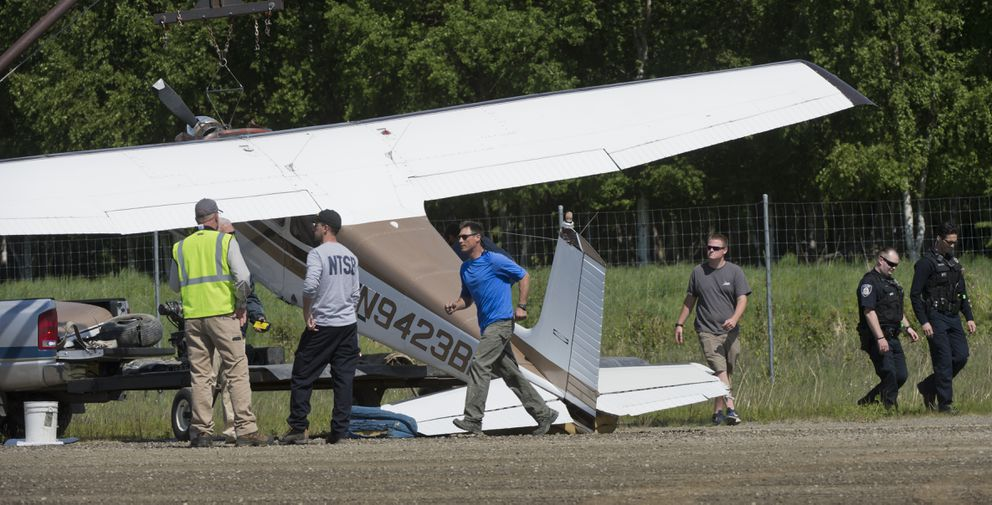 A damaged plane is loaded onto a trailer at the Lake Hood airstrip Wednesday.  (Marc Lester / ADN)