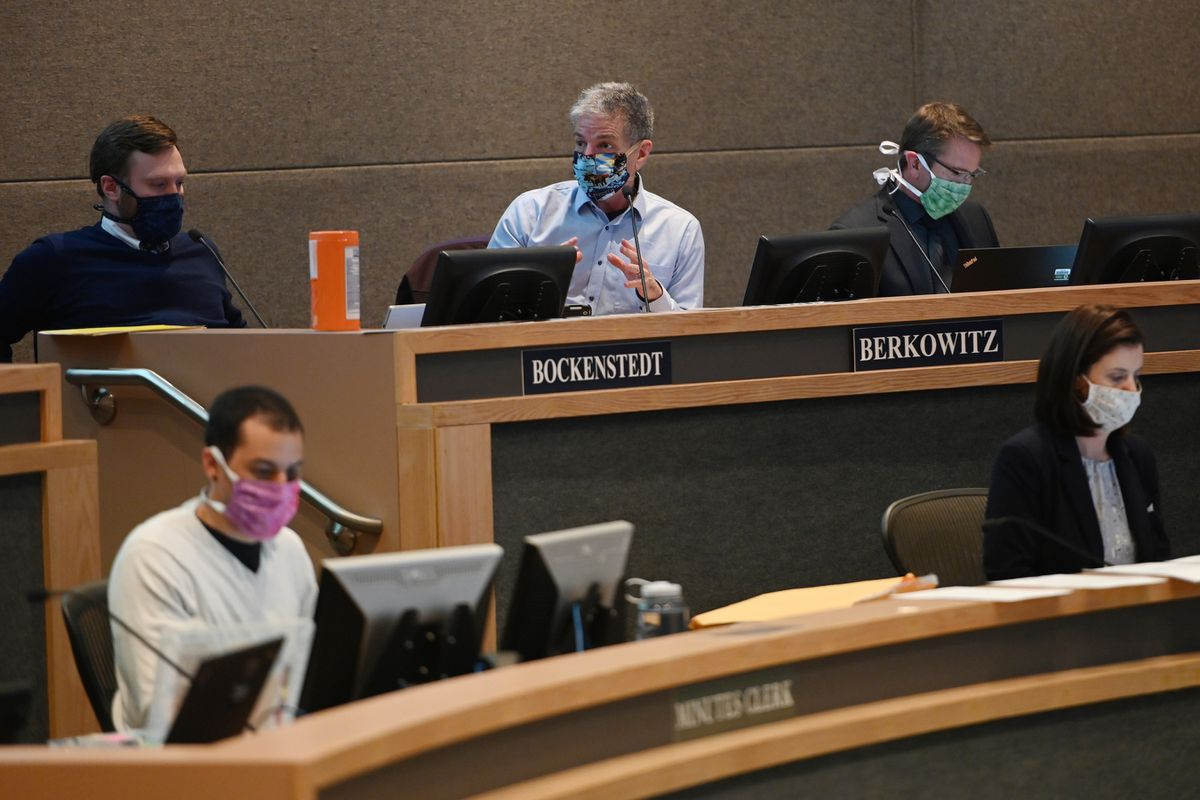 Anchorage Mayor Ethan Berkowitz, center, gives his report during the Anchorage Assembly meeting on Tuesday, April 14, 2020, during the COVID-19 pandemic. (Bill Roth / ADN)