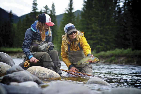 A handout photo of Timbre Pringle showing off a cutthroat trout in Alberta, Canada. Women are the fastest growing demographic in fly fishing, one of the most male-dominated outdoor sports. (Faceless Fly Fishing, via Orvis via The New York Times) -- NO SALES; FOR EDITORIAL USE ONLY WITH FLY FISHING WOMEN BY JOHN CLARKE FOR DEC.11, 2017. ALL OTHER USE PROHIBITED. --