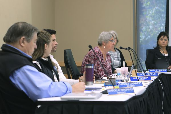 Regent Karen Perdue, center, speaks at an emergency meeting of the University of Alaska Board of Regents on Monday, July 22, 2019, in Anchorage, Alaska. Regents voted 10-1 to declare a financial exigency, allowing administrators to expedite layoffs of tenured faculty in the face of severe budget issues. (AP Photo/Dan Joling)