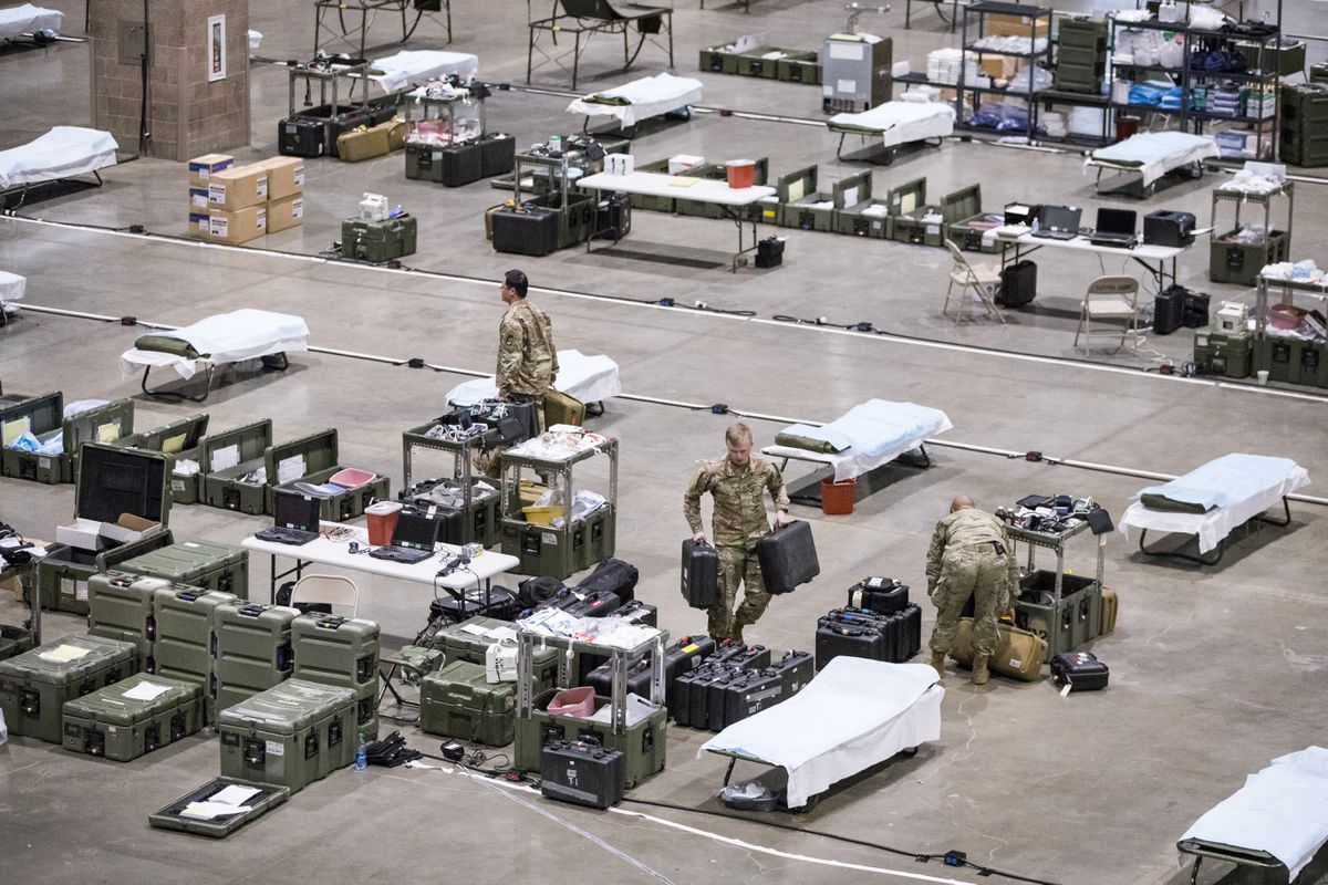 Army soldiers from Fort Carson and Fort Lewis set up the Intermediate Care Ward at the field hospital for non-COVID-19 patients at CenturyLink Field Events Center. (Amanda Snyder/Seattle Times/TNS)