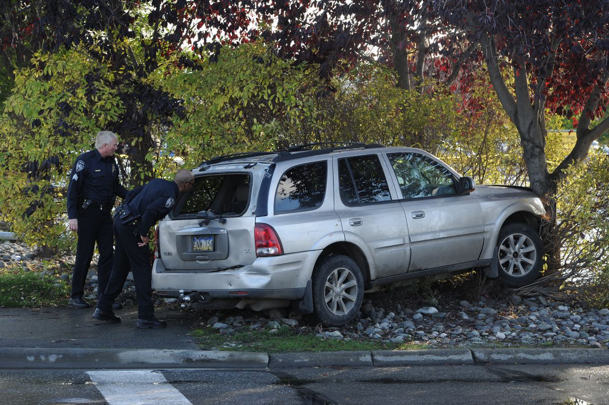 Anchorage police investigating two armed robberies and an officer involved shooting in September 2017 attempted to stop the suspect vehicle in the area of Dimond Boulevard and C Street before it crashed. (Bill Roth / Alaska Dispatch News)
