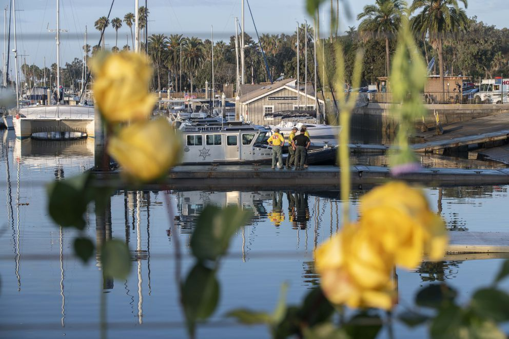 Divers with the San Luis Obispo County Sheriff's Dive Team prepare to search for a second day for missing people following a dive boat fire off Southern California's coast that killed dozens sleeping below deck, in Santa Barbara, Calif., Tuesday, Sept. 3, 2019. (AP Photo by Christian Monterrosa )