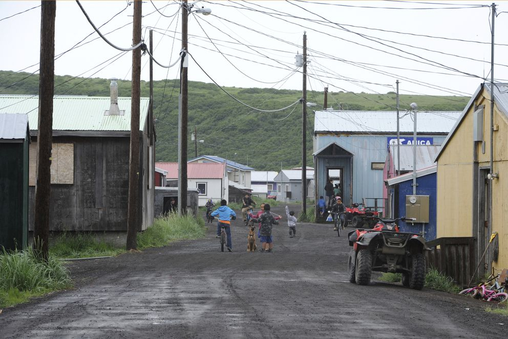 In this June 26, 2019 photo, children play on the main road of Stebbins, a Norton Sound village. (Bill Roth / ADN archive)