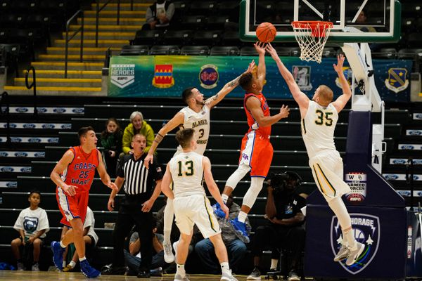 UAA's Niko Bevens and Oggie Pantovic try to block a Coast Guard shot during the Armed Forces Classic Friday, Nov. 8, 2019 at the Alaska Airlines Center in Anchorage. (Loren Holmes / ADN)