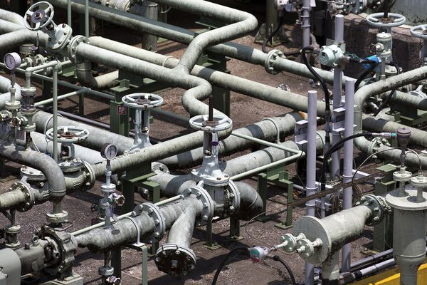 Pipes near a liquefied natural gas (LNG) tank in Japan. MUST CREDIT: Bloomberg photo by Tomohiro Ohsumi.