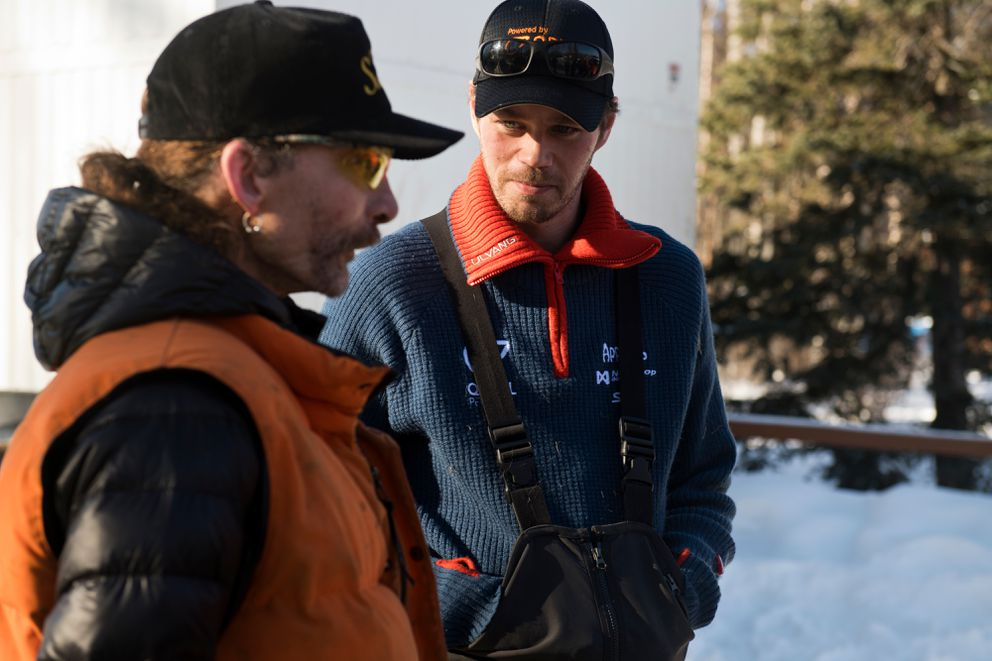 Lance Mackey, left, talks with Joar Leifseth Ulsom during a stop at Iditarod Headquarters in Wasilla on February 27, 2019. (Marc Lester / ADN)