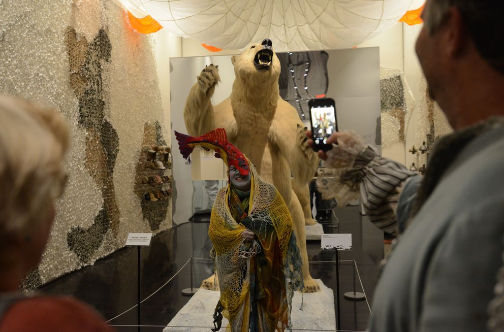 "Lucy Zercher in her costume ""Caught Me"" poses in front of the Polar Bear in the Camouflage: in Plain Sight exhibit during the Anchorage Museum's Halloween party at the museum in Anchorage, Alaska, on Friday, October 28, 2016. (Bob Hallinen / Alaska Dispatch News)"