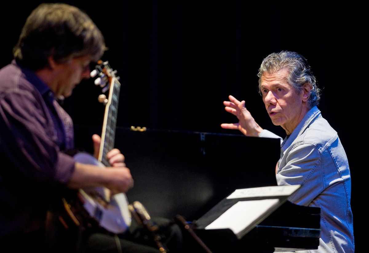 Multiple Grammy Award-winning artists Béla Fleck, left, and Chick Corea play for a full house during a Juneau Arts & Humanities Council sponsored event at the Juneau-Douglas High School auditorium on Monday, April 28, 2014, in Juneau, Alaska.